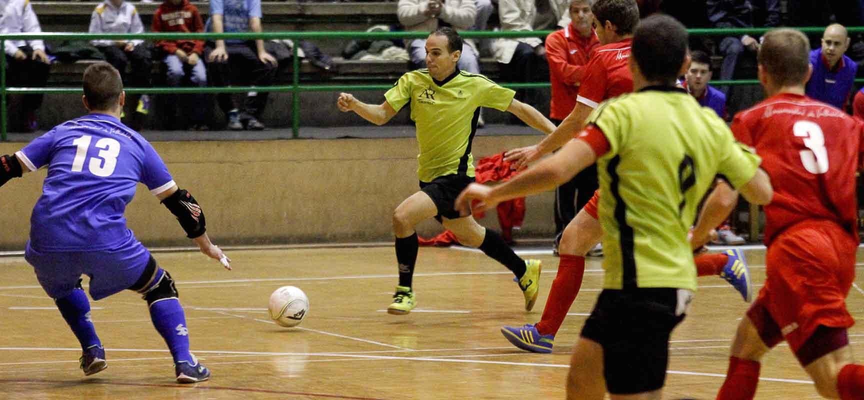Imagen de un partido entre el FS Cuélar Cojalba y UVa.