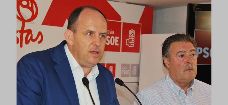Acebes y López en la sede del PSOE.