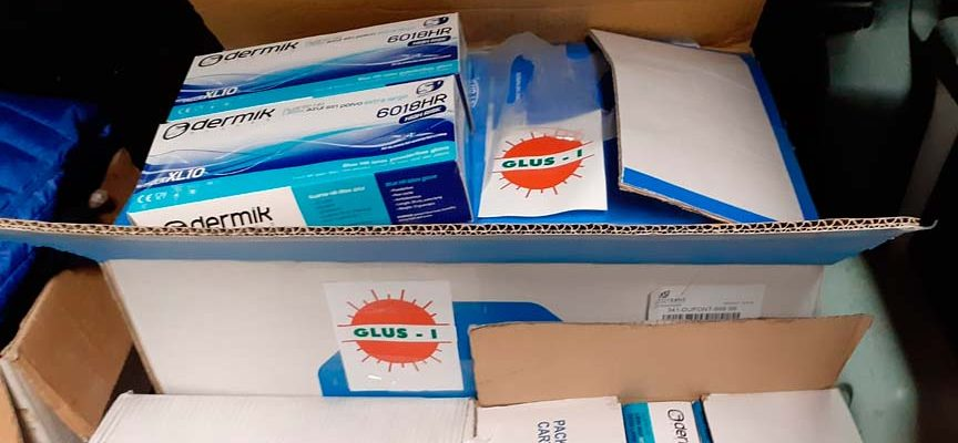 Cooperativa GLUS I dona buzos de protección y guantes para los sanitarios